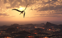 A pair of giant Quetzalcoatlus flying over a volcanic landscape.