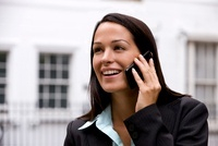 A businesswoman talking on a mobile phone