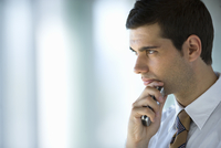 Serious businessman holding cell phone