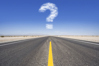 Question mark cloud hovering over remote desert road