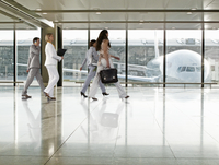 Business people walking in airport terminal