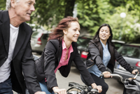 Business people commuting on bicycles
