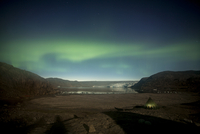 Northern green lights or Aurora Borealis over tent