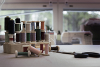 Variety of thread spools on table at home
