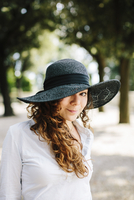 Portrait of smiling woman wearing sun hat