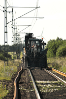 Young man operating track maintenance vehicle