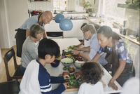 High angle view of family preparing Asian food at table