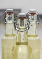 Yellow juice in airtight bottles
