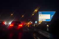 Blurred view of illuminated traffic on city street