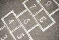 Directly above shot of hopscotch board drawn on street