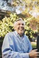 Smiling senior man looking away at outdoors cafe