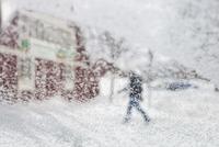 Defocused image of person walking in snowy weather