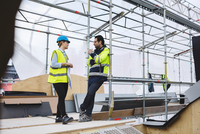Low angle view of female and male managers planning at construction site