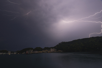 Scenic view of lake against lightning at night