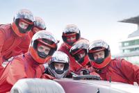 Race car team at pit stop