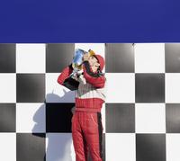 Racer kissing trophy at award ceremony