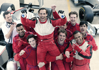 Racer and team cheering in garage