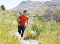 Man running on dirt path 11086004338| 写真素材・ストックフォト・画像・イラスト素材|アマナイメージズ