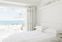 Modern bedroom overlooking beach and ocean
