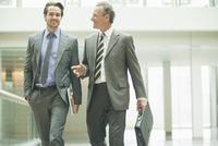 Businessmen talking in office lobby
