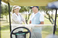 Senior couple laughing on golf course