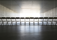 Silhouette of office chairs lined up in a row