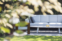 Sofa and armchair in backyard