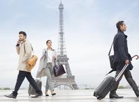 Business people walking near Eiffel Tower, Paris, France