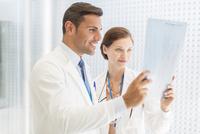 Doctors examining x-ray in hospital
