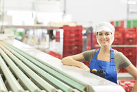 Portrait of confident worker in food processing plant