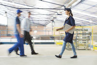 Workers walking in food processing plant