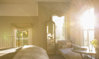 Sun shining in luxury bedroom
