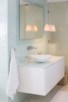 Sink, mirror and lamps in modern bathroom