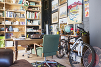 Desk, bookshelves and bicycle in study