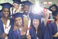 Portrait of university students standing in corridor after graduation ceremony 11086019772| 写真素材・ストックフォト・画像・イラスト素材|アマナイメージズ
