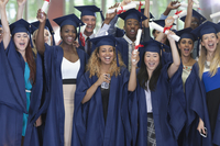 Group of students in graduation clothes posing together for group portrait