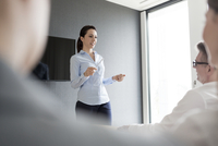 Businesswoman leading conference room meeting