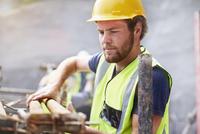 Construction worker lifting rebar