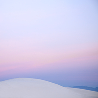 Pink sunset sky over white sand dune, White Sands, New Mexico, United States