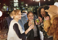 Young women drinking and enjoying rooftop party