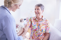 Doctor checking senior woman's arm in checkup