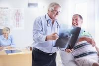 Doctor showing senior man x-ray