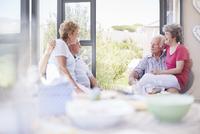 Senior couples talking on patio