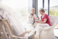 Senior women using cell phone on patio