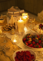 Food and decorations on candlelight Christmas table