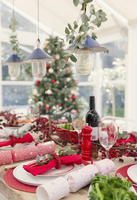 Placesetting and Christmas decorations on dining table