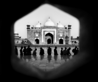 Silhouette of people facing the Taj Mahal, Agra, India