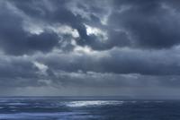 Dark clouds in overcast sky over ocean, Devon, United Kingdom