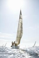 Sailboats on sunny ocean
