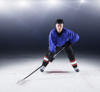 Portrait confident hockey player on ice